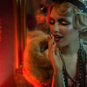 Retro portrait of a beautiful Gatsby woman. Vogue fashion style and smoke